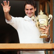 Roger Federer holds up the winner's trophy and waves to the crowd after winning the gentlemen's singles final against Andy Murray at Wimbledon; Getty Images