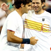 Roger Federer and Mardy Fish shared a respectful handshake after the Swiss defeated Fish 6-3 7-6(4) in the Cincinnati quarterfinals; Getty Images