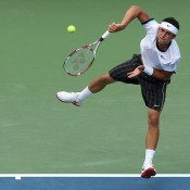 Pictured here landing a wicked kick serve against Roger Federer, Cincinnati marked an encouraging return to form for Bernard Tomic, who enjoyed impressive straight-set wins over Ryan Harrison and Brian Baker before falling to Federer in straight sets in the third round; Getty Images