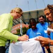 NEW YORK, NY - AUGUST 23: Kim Clijsters of Belgium signs her autograph for fans during a clinic prior to the start of the 2012 U.S. Open at the USTA Billie Jean King National Tennis Center on August 23, 2012 in the Flushing neighborhood, of the Queens borough of New York City.  (Photo by Chris Trotman/Getty Images for USTA)