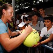 NEW YORK, NY - AUGUST 23: Samantha Stosur of Australia signs her autograph for fans prior to the start of the 2012 U.S. Open at the USTA Billie Jean King National Tennis Center on August 23, 2012 in the Flushing neighborhood, of the Queens borough of New York City.  (Photo by Chris Trotman/Getty Images for USTA)