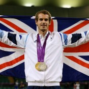 A national hero, Andy Murray of Great Britain poses with his gold and silver medals while wrapped in the Union Jack flag at the conclusion of the London 2012 Olympic Games tennis event at the All England Club; Getty Images