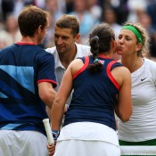 Laura Robson and Andy Murray (near side) of Great Britain greet Victoria Azarenka and Max Mirnyi of Belarus at the net after the Belarusians won their mixed doubles gold medal match 2-6 6-3 [10-8]; Getty Images