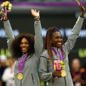 Gold medallists Serena Williams (L) and Venus Williams of the United States of the United States celebrate on the podium during the women's doubles medal ceremony; Getty Images