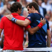 Andy Murray (R) of Great Britain embraces Roger Federer of Switzerland at the net after the men's singles Gold Medal Match on Day 9 of the London 2012 Olympic Games at the All England Club; Getty Images
