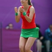 Victoria Azarenka of Belarus celebrates after defeating Maria Kirilenko of Russia to win the bronze medal in the women's singles at the London 2012 Olympic Games; Getty Images