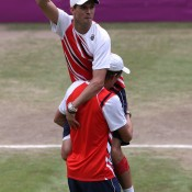 Mike Bryan (R) and Bob Bryan (L) celebrate after defeating Jo-Wilfried Tsonga and Michael Llodra of France in the men's doubles gold medal match on Day 8 of the London 2012 Olympic Games at the All England Club; Getty Images