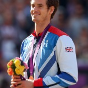 Gold medallist Andy Murray of Great Britain is all smiles during the men's singles medal ceremony at the London 2012 Olympic Games; Getty Images