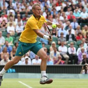 Lleyton Hewitt dons the Aussie green-and-gold on Wimbledon's Centre Court against Novak Djokovic in the third round; Getty Images