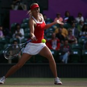 Russian flagbearer Maria Sharapova wears an outfit featuring her nation's colours during her quarterfinal win over rival Kim Clijsters of Belgium; Getty Images