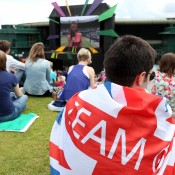 British fans in their national colours are out in force on Henman Hill (aka Murray Mound) to watch the specially-decorated big screen during the London Olympics tennis event; Getty Images
