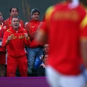 Wearing enough red to enrage a bull, members of the Spanish Olympic tennis team cheer countrymen David Ferrer on during his third round match against Japan's Kei Nishikori, which he eventually lost; Getty Images
