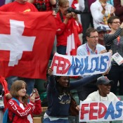 Swiss fans form a colourful army in the No.1 Court stands as they cheer on Roger Federer during his third round victory over Denis Istomin of Uzbekistan at the London 2012 tennis event; Getty Images