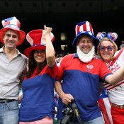 American fans cheer on their charges at the All England Club in Wimbledon during the London 2012 Olympics tennis event; Getty Images