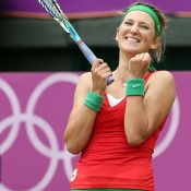 Wearing the colours of her country's flag, Belarusian Victoria Azarenka  celebrates after defeating Angelique Kerber of Germany in the women's singles quarterfinals at the London 2012 Olympic Games; Getty Images