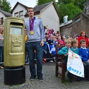 Andy Murray poses next to a post box which was painted gold by the Royal Mail in recognition of his Olympic gold medal, after he returned to Dunblane, Scotland following his win in the US Open and his gold medal performance in the 2012 Olympic games in London. Thousands lined the streets of his hometown as the 25-year-old returned to meet with family and friends following his summer triumphs; Getty Images