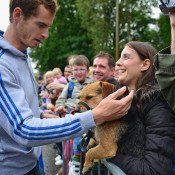 Andy Murray pats a fan's dog as he returns to Dunblane following his win in the US Open and at the 2012 Olympic games in London. Murray is a dog lover, and owns two border terriers named Maggie and Rusty; Getty Images