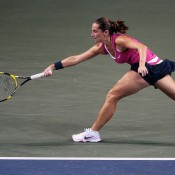 Roberta Vinci hits a forehand during her first round match against Barbora Zahlavova Strycova on Day 1 of the Toray Pan Pacific Open, as tennis in Asia continues onto Tokyo for the prestigious event at the Ariake Colosseum; Getty Images