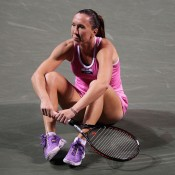 Jelena Jankovic of Serbia takes a rest on court during her first round match against Yanina Wickmayer of Belgium at the Toray Pan Pacific Open at Ariake Colosseum in Tokyo, Japan. Jankovic went on to win the match before falling to Agnieszka Radwanska in the second round; Getty Images