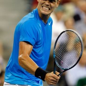 Tomas Berdych fires up to end Roger Federer's campaign for a record sixth US Open title. Berdych came from an early break down in the first set to win in four against the world number one, ensuring this became the first major without Federer or Nadal in the semifinals since the 2004 French Open.