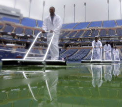 Drying the courts at US Open 2012. GETTY IMAGES