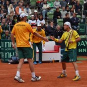 Chris Guccione (left) and Lleyton Hewitt celebrate winning a point. TENNIS AUSTRALIA