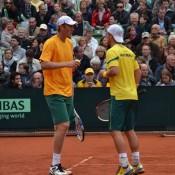 Chris Guccione (left) and Lleyton Hewitt talk tactics, Hamburg, 2012. TENNIS AUSTRALIA