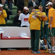 Hugs all round: team captain Pat Rafter and Lleyton Hewitt embrace after the doubles rubber. TENNIS AUSTRALIA