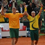 Take a bow: Chris Guccione (left) and Lleyton Hewitt after winning the doubles rubber. TENNIS AUSTRALIA