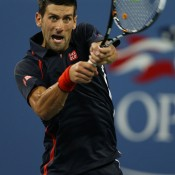 Defending champion Novak Djokovic has his eye on the ball during his quarterfinal match against Juan Martin Del Potro. Djokovic produced a stellar 85-minute second set to overcome the Argentinean in straight sets, making him the only Grand Slam champion still fighting for the men's title.