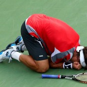 David Ferrer falls to his knees on the court he'd played on for 4 hours and 31 minutes to outlast Serbia's Janko Tipsarevic in what was the longest match of the 2012 tournament. The only other year Ferrer made it past the fourth round in New York was in 2007, when he also made the semifinal.