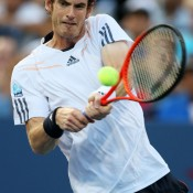Andy Murray puts his weight behind a backhand against Marin Cilic in the quarterfinal, fighting back from an early deficit to overcome the Croatian in an impressive 3-6 7-6(4) 6-2 6-0 victory. With Federer and Nadal out of the race, Murray is a firm favourite to clinch a debut Grand Slam title.
