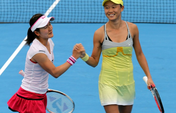 Kai-Chen Chang (R) of Chinese Taipei celebrates with Shuko Aoyama of Japan; Getty Images