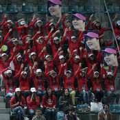 Fans of China's Li Na urge her on during her women's singles third round match against compatriot Peng Shuai at the China Open in Beijing; Getty Images