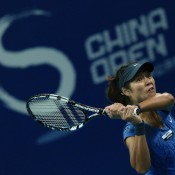 Li Na returns a shot to Agnieszka Radwanska during their China Open quarterfinal in Beijing; Getty Images