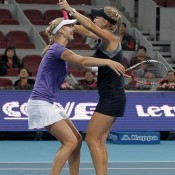 Elena Vesnina (R) and Ekaterina Makarova celebrate winning against Nuria Llagostera Vives of Spain and Sania Mirza of India in the women's doubles final at the China Open in Beijing; Getty Images