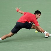 Novak Djokovic demonstrates his trademark flexibility and retrieving skills in his second round victory over Grigor Dimitrov at the Shanghai Rolex Masters in Shanghai, China; Getty Images