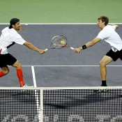 Philipp Petzchner of Germany (donning striking orange knee-high socks) and Eric Butorac of the United States are on the ball against Mike and Bob Bryan of the United States during the Shanghai Rolex Masters; Getty Images
