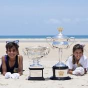 L-R) Jacob Meersbergen, Zachary Scott-Jones, Jaylee Johnson and Eytahnyia Scott-Jones pose with the Australian Open trophies at Gove Peninsula's East Woody Beach; Tennis Australia
