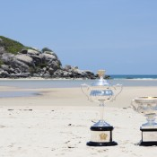 The Daphne Akhurst Memorial Cup (L) and the Norman Brookes Challenge Cup at Gove Peninsula's East Woody Beach as part of the Australian Open Trophy Tour; Tennis Australia