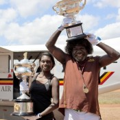 Aboriginal elder Gurramin Marika and his daughter pose with the Australian Open trophies at Laynhapuy Aviation station; Tennis Australia