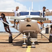 (L-R) Eytahnyia Scott-Jones, Jacob Meersbergen, Zachary Scott-Jones and Jaylee Johnson with the Australian Open trophies at Laynhapuy Aviation station at Gove Peninsula in the Northern Territory; Tennis Australia