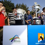 Chinese tennis fans look at the Australian Open trophies during the Australian Open Trophy Tour, which visited Nanjing Sport Institute on October 15, 2012 in Nanjing, China; Getty Images