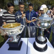 Chinese tennis fans look at the Daphne Akhurst Memorial Cup (women's trophy, right) and the Norman Brookes Challenge Cup (men's trophy) during the Australian Open Trophy Tour, which visited Nanjing Sport Institute on October 15, 2012 in Nanjing, China; Getty Images