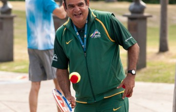 National Indigenous Coach and MLC Tennis Hot Shots coach Ian Goolagong at a Hot Shots demonstration event at Melbourne Park as part of the Australian Open 2013 Launch; Tennis Australia