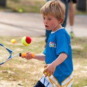 A young player takes part in a MLC Tennis Hot Shots demonstration as part of the Australian Open 2013 Launch at Melbourne Park; Tennis Australia