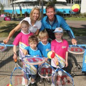 Former tennis players Alicia Molik and Wayne Arthurs pose with children during the 2013 Australian Open launch at Melbourne Park on October 2, 2012 in Melbourne, Australia; Getty Images