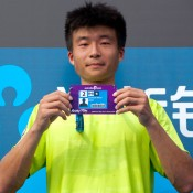 Di Wu of China holds his pass into the main draw of Australian Open 2013 after defeating Danai Udomchoke in the men's singles final of the Asia-Pacific Australian Open Wildcard Play-off in Nanjing, China; Getty Images