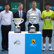 (L-R) tournament referee Wayne McKewen, Chinese women's tennis team head coach Hongwei Jiang, Tennis Australia president Stephen Healy, tournament director Alistair MacDonald, Di Wu of China and Danai Udomchoke of Thailand at the ceremony following the men's singles final of the Asia-Pacific Australian Open Wildcard Play-off in Nanjing, China; Getty Images