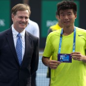 Tennis Australia president Stephen Healy (L) and Di Wu; Getty Images
